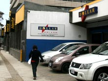 Hertz Costa Rica Rent a Car and Dollar Rent a Car are located next to each other on Paseo Colon, San Jose. The building in the background is the Edificio Colon, a landmark often used for giving directions.