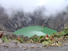 The color of the crater lake changes between green and chartreuse.