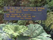 A sign warns visitors that the volcano is active.