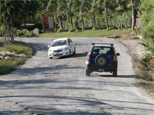 There are many potholes in the mains street of Malpais Beach.
