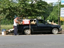Cold coconuts (pipas frias) are sold in the street in Puerto Viejo de Sarapiqui.