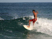 Surfers from all over the world come to Tamarindo beach because of the great waves.